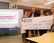 Ian Robb, BTA Chairman, presents $65,000 cheque from the BTA Charitable Foundation to the Secord Community League